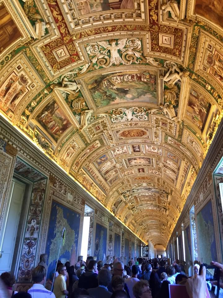 This is the inside of the Vatican Museum, the paintings, frescoes, and mosaic on the ceilings date back 400 yrs